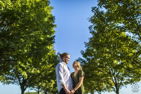 On location Elmington Farm, Berryville couple engagement portrait shootthat is Framed by the trees lining the long drive