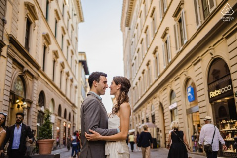 On location Florence couple engagement portrait shooton the busy city streets