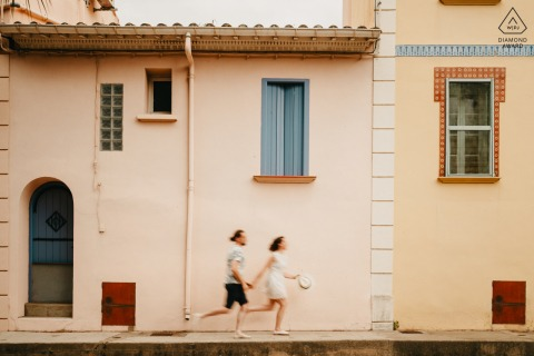 Outdoor Perpignan couple engagement photography portrait using slow camera shutter speed and running in the city