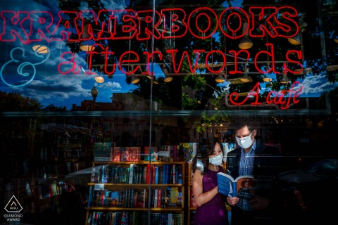 Kramerbooks, DC engagement photography portrait as The couple reads a memoir of RBG while wearing masks