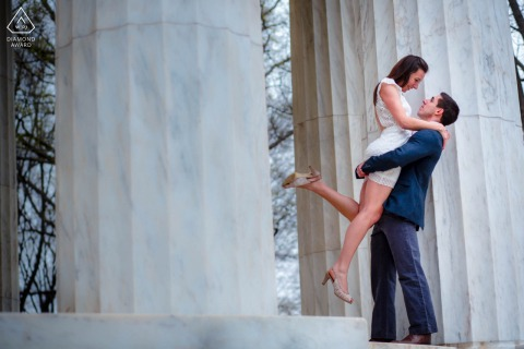 The National War Memorial, DC outside environmental couple prewedding photoshootshowing The groom-to-be lifts his fiance