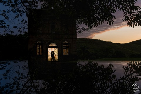 On location São Luis do Quitunde - AL couple engagement portrait shoot with a dusk Silhouette in an arched doorway
