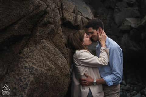 Pleneuf Val Andre, France environmental couple pre wedding image session against the rock cliffs