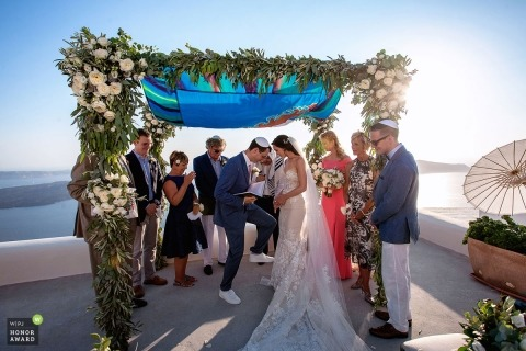 Elena Haralabaki is an award-winning wedding photographer of the AT WPJA