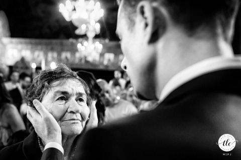 The groom comforts his emotional grandmother at Avrig Church wedding ceremony