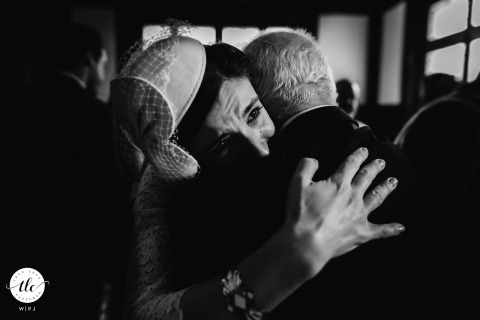 Paris France wedding image of the Bride and her father huging