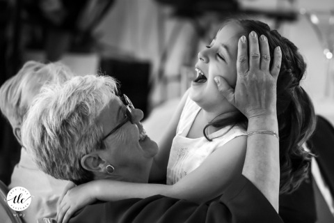 Al Frassino Restaurant - Peschiera del Garda - Verona - Italy wedding image of The groom's mother letting herself go to emotions with her granddaughter