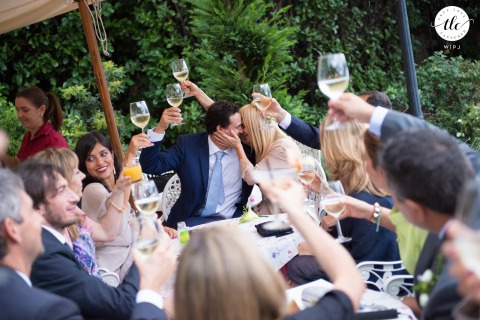 Il Molo di Varenna at Lake Como wedding moment photo showing True Love seen through Guest Toasting in Italy