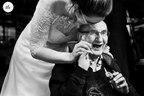 Joe Mann Best wedding moment photograph from The Netherlands captured as the Bride hugs father who suffers from dementia