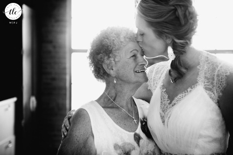 Golden Gardens Seattle Washington wedding photography moment from when the Bride kisses grandma on her forehead