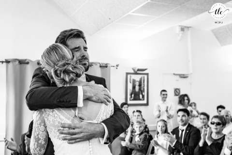 Arette, Pyrénées, France wedding ceremony moment created as The groom embraces his bride with emotion