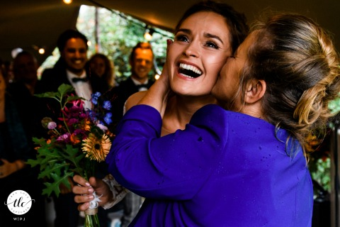 Noord-Holland wedding reportage moment of some good luck wishes just before ceremony