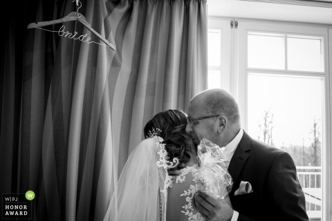 Heidelberg  bride receives a hug and a kiss from her father before the ceremony