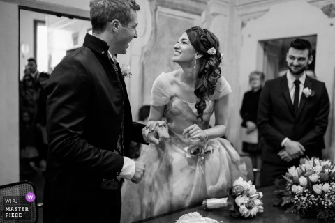 Brescia bride and groom smile at each other at the wedding