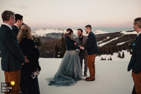 Vail, Colorado bridal party outside in the snow during the Mountain top wedding ceremony
