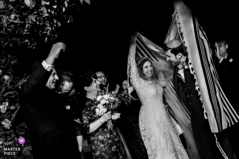 Israel, Jerusalem bride and groom smile at each other during the wedding ceremony