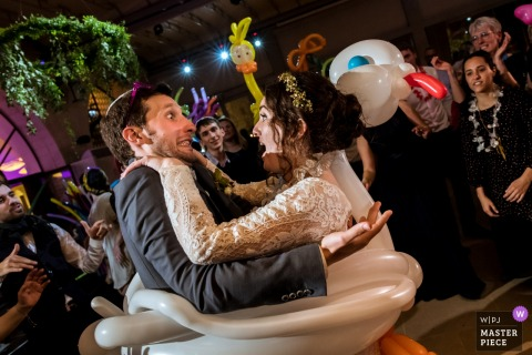 Israel, Jerusalem bride and groom dance in a swan pool raft at the reception