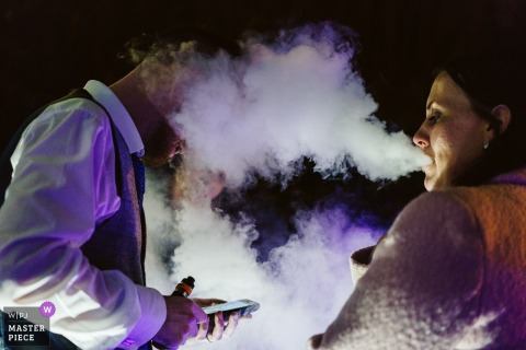 Cheshire, England bride smokes into the grooms face whiles he's on the phone
