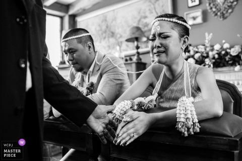 Bangkok bride and groom get emotional during the wedding ceremony