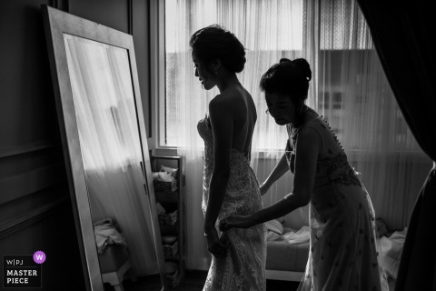 Bride getting dressed at Daly City studio - California Wedding Photo