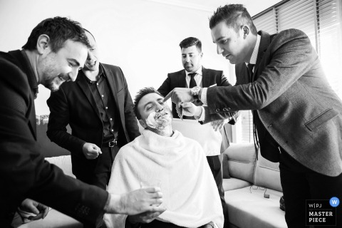 Veria, Greece groomsmen shave the grooms beard before the wedding