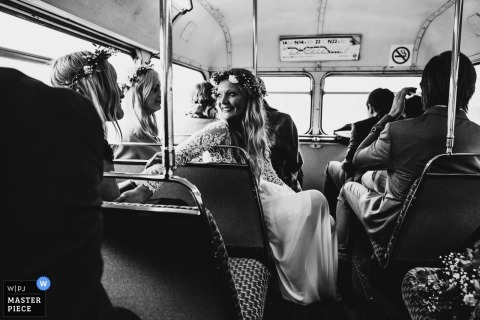Bride on a bus somewhere in London with guests - Wedding Transportation Photo