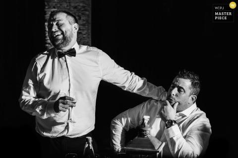 Juigne sur Loire groom and best man enjoy drinks at the reception