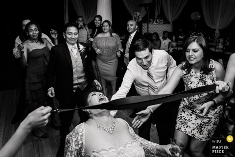 Quito, Ecuador guests and bridal party playing limbo at the wedding reception