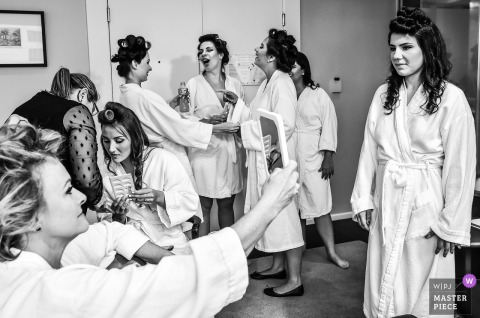 Sao Paulo bridesmaids and bride talking to each other while getting ready for the wedding
