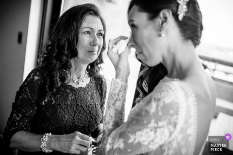 Thompson Chicago bride starts to cry with her mother before the wedding ceremony