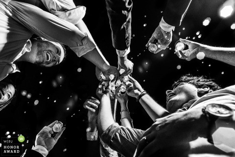 São Paulo wedding reception Photo in black-and-white of guests toasting - low angle photography