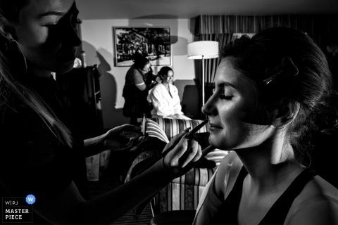 Montreal, Quebec bride and bridesmaid getting make up and hair done before the wedding ceremony