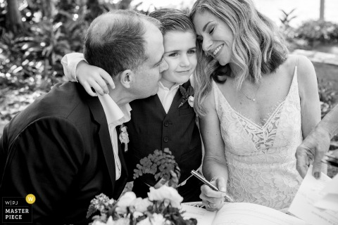 Sydney, Australia Wedding Photo of Certificate signing with Bride, Groom and young boy.