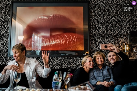 opus hotel, Vancouver, BC - British Columbia Wedding Photo of guests with selfie poses and wall art of lips