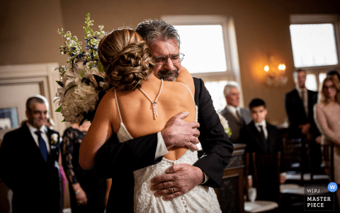 New Jersey Davids Country Inn Wedding Photo of Dad Hugging Bride During the Ceremony