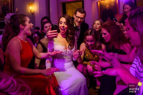New York City guests playing a game with the bride at the reception