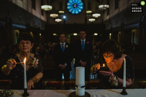 Buffalo, New York Church wedding photos - the mothers light their part of the unity candle