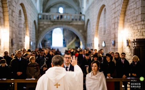 Périgord, France photographer - the priest blesses the couple during Church ceremony