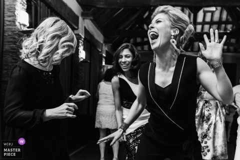 France wedding photography of Women dancing at Fief de la Thioire reception