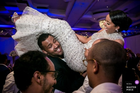 Ethiopia bride getting carried by the groomsmen at the wedding reception