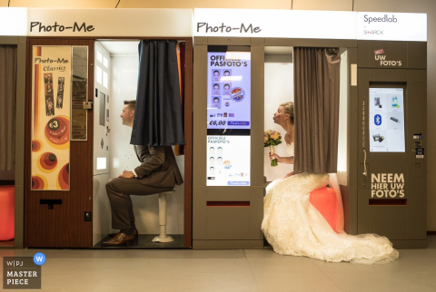 Amsterdam bride and groom taking photos in separate photo booths
