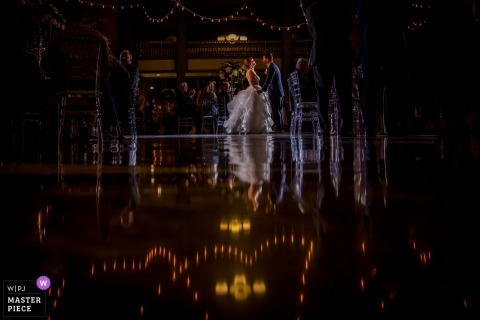 Chicago, Illinois bride and groom hold hands on the dance floor at the reception