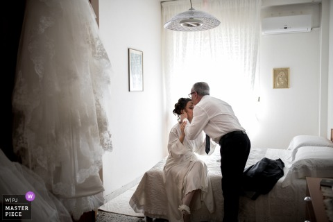Sardinia brides father kisses her on the forehead before the wedding