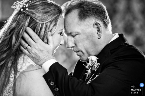 New Jersey bride hugs father before the wedding ceremony