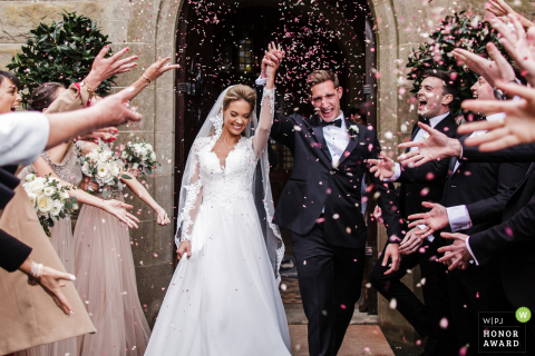 Kildare, Ireland wedding ceremony photography - the bride and groom are showered with confetti after their church vows