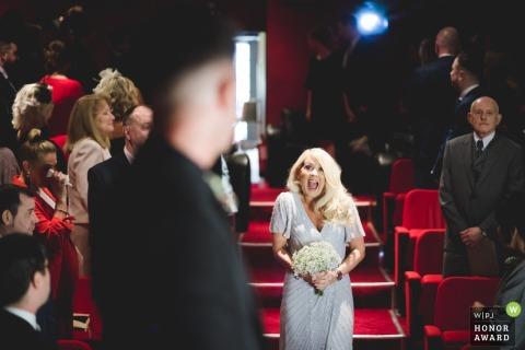 Electric Cinema, Birmingham wedding ceremony photography - the bride expresses joy as she enters the ceremony