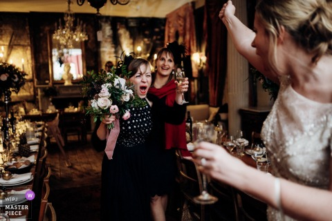 England guests celebrate with drinks with the bride