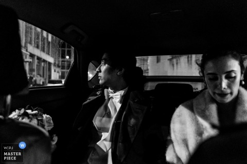 England bride and groom sitting in the car after the wedding