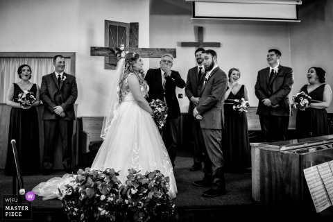 Bridal party laughs during the wedding ceremony in Edmonton, Canada