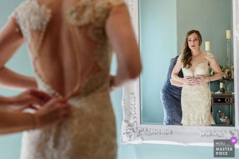 Temecula, California bride getting help putting her dress on